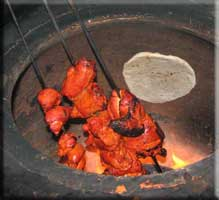 Chicken and nan in the tandoori oven